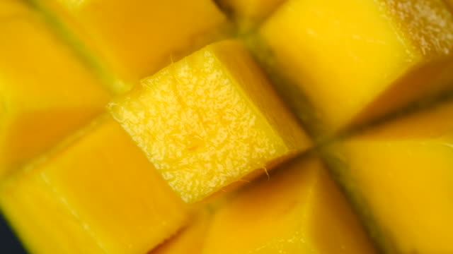Rotation close-up of rip mango slice cubes cut in 4K resolution Rotation close-up of rip mango slice cubes cut in 4K resolution mango stock videos & royalty-free footage