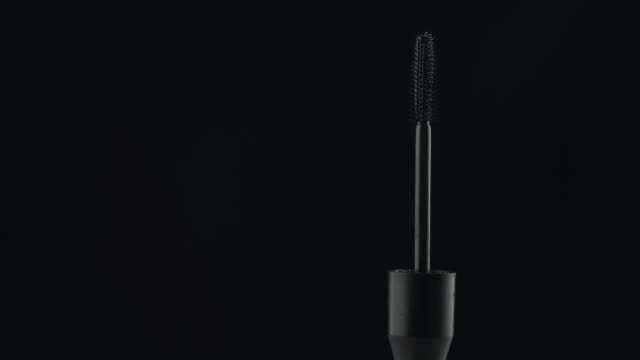 Rotation, mascara tassels on a black background. Rotation, mascara tassels on a black background. Fashion industry with copy space. mascara stock videos & royalty-free footage