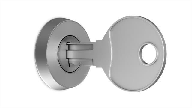 vídeos de stock e filmes b-roll de rotation metallic key on white background. isolated 3d render - chave