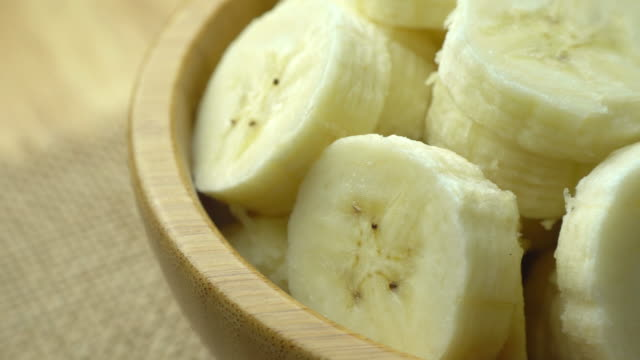 Rotation of sliced bananas, close-up, 4K video