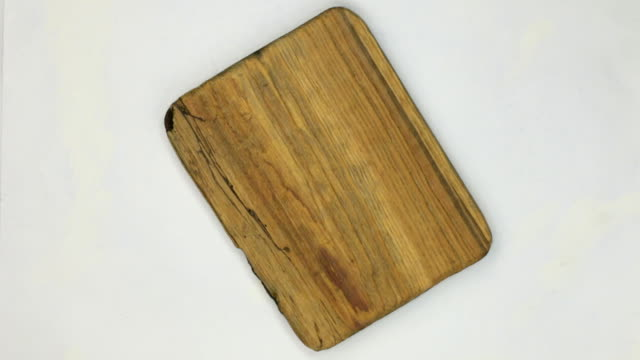 Rotation of the frame made of rectangular pine wood with cracks video
