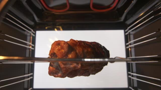 Rotisserie roast pork meat grilling inside modern electric oven video