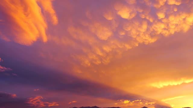 Rotor cloud and festoon (mammatocumuli) clouds at sunset