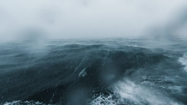 rough boat journey across ocean seascape during extreme weather monsoon storm - ruvido video stock e b–roll