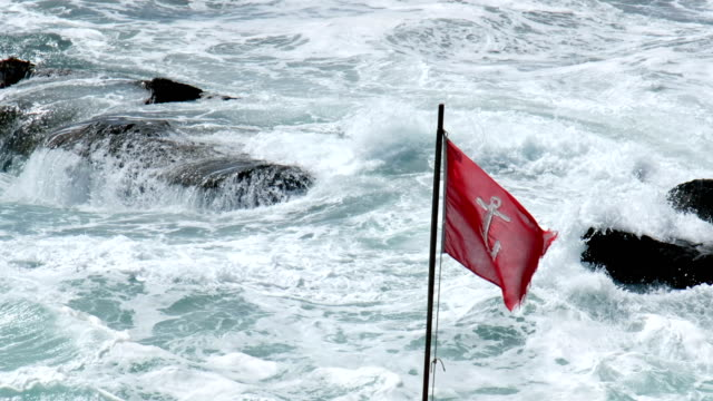 rough storm sea red flag anchor background rough storm sea red flag anchor background . environmental consciousness stock videos & royalty-free footage
