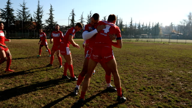 Rough training Young and strong rugby team on the field, hard group training. practice drill stock videos & royalty-free footage