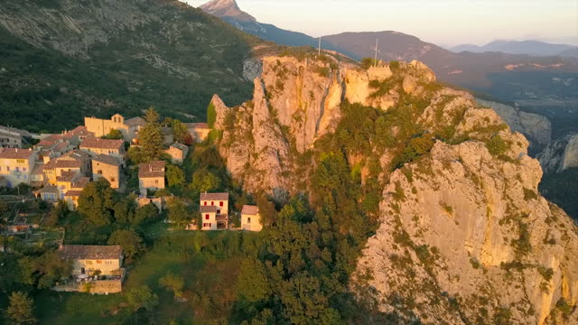 Rougon Mountain Village Aerial Sunset Aerial footage of a flyby of the historic mountain village Rougon in France during sunset country geographic area stock videos & royalty-free footage