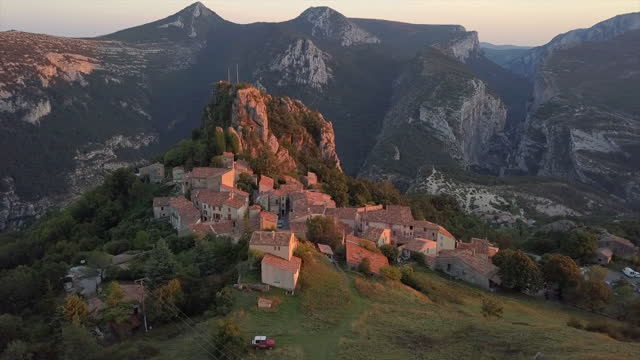 Rougon Mountain Village Aerial Flying around the French village Rougon with the sun setting behind the mountains country geographic area stock videos & royalty-free footage