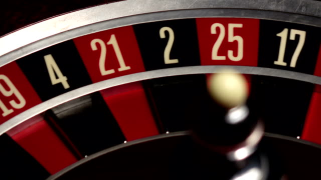 Roulette spins quickly, ball, white, close up video