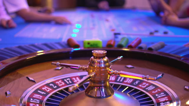 Roulette table in a casino - spinning wheel - ball lands on field 9 red video