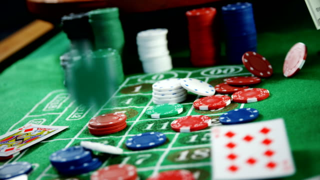 Roulette wheel, dollar, casino chips and playing cards on roulette 4k video