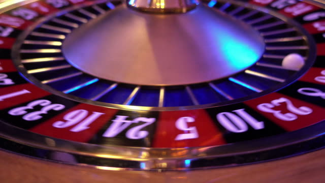 Roulette Wheel in a casino - ball falls on 11 black video
