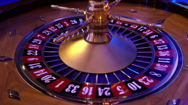 Roulette Wheel in a casino - ball on field 25 red video