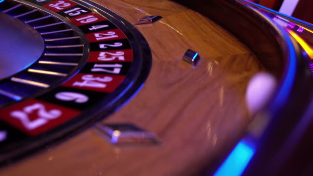 Roulette Wheel in a casino - running ball falls in field 6 black video