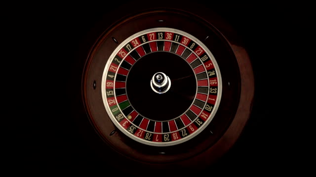 Roulette wheel is spinning slowly then stops black video