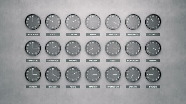 Round clocks show different time zones on a dark concrete wall. Loopable clock face timelapse. Round clocks show different time zones on a dark concrete wall. Loopable clock face timelapse 60 fps animation time zone stock videos & royalty-free footage