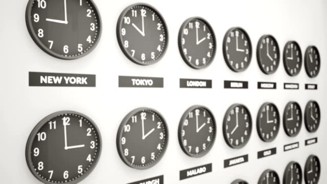 Round Clocks Show Time In Different Cities On White Wall. Symbol For Greenwich Mean Time. Clock Face Timelapse Round Clocks Show Time In Different Cities On White Wall. Symbol For Greenwich Mean Time. Clock Face Timelapse 60fps Animation. time zone stock videos & royalty-free footage