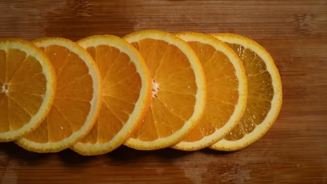 Round slices of orange on a cutting board video