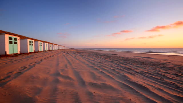 Row of beach huts at sunset, Texel island, The Netherlands video