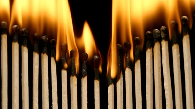 SLOW MOTION: Row of burning matchsticks video