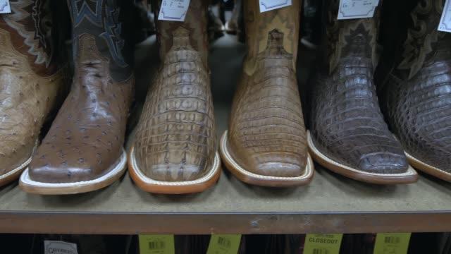 Row of cowboy boots on shelf