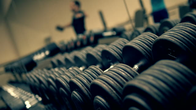 Row of dumbbells in modern sports club video