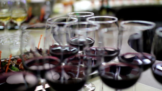 row of elegant red wine glasses on the bar video
