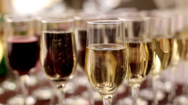 Row of glasses of champagne on table, close-up. video