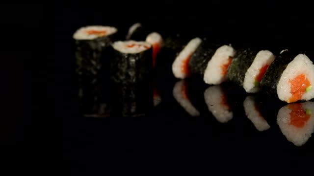 Row of japanese sushi on black background close-up