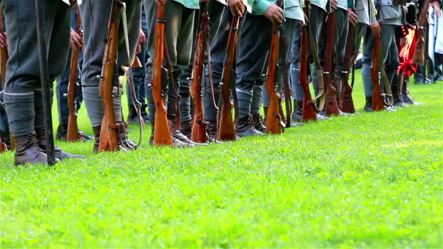 Row of soldiers with weapons video