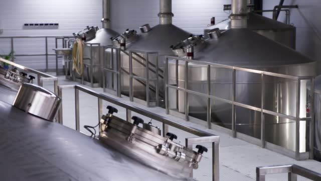 row of tanks in brewery. - attrezzatura industriale video stock e b–roll