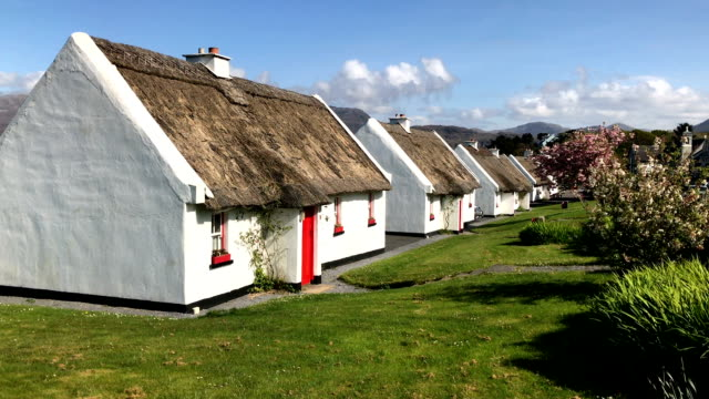 Row of thatched roof cottages in a street in Ireland near Galway video