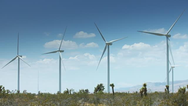 Row of Wind Turbines on Hill Ridge video