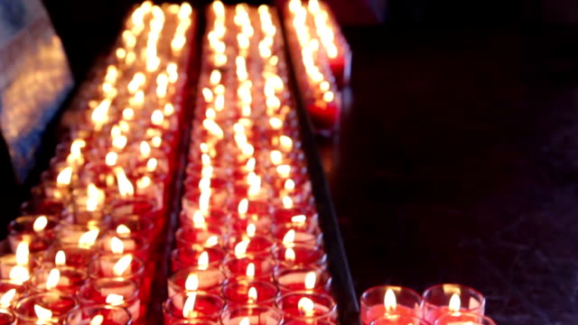 Rows of burning candles at the Chinese temple video
