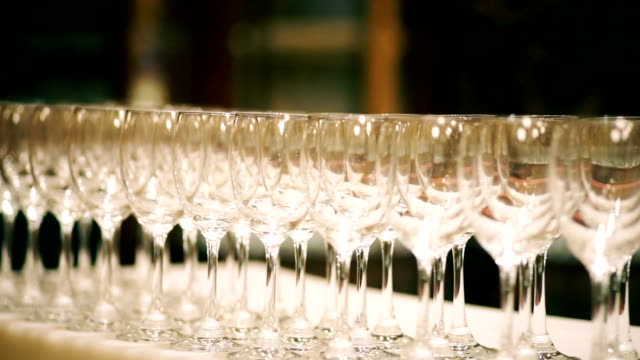 Rows of empty wine glasses on the table.