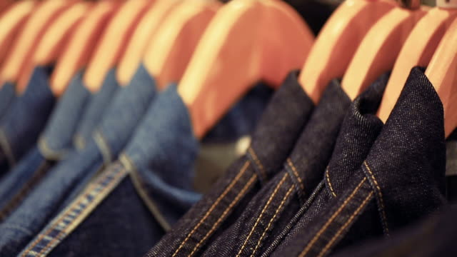 Rows Of Hangers With Jeans Jacket