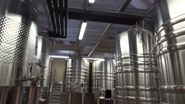 Rows of modern Stainless steel tanks in winemaker factory, Gironde, France
