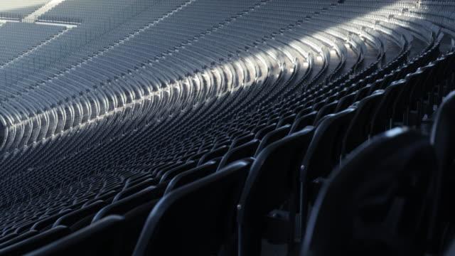 rows of seats in football stadium in 4k - mebel do siedzenia filmów i materiałów b-roll