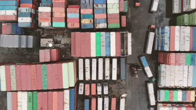 Rows of Shipping Containers in Port Terminal