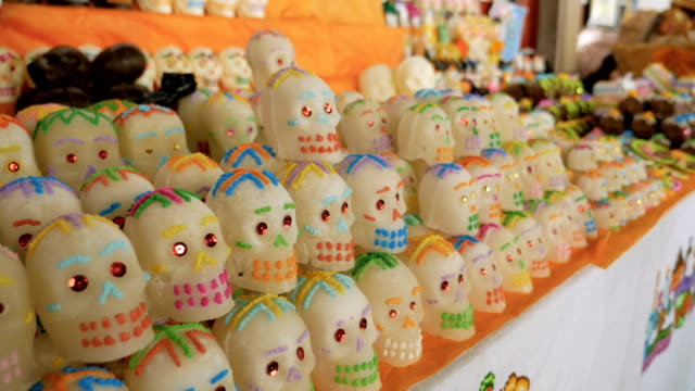 Rows of sugar skulls for sale on display for Day of the Dead in Mexico video