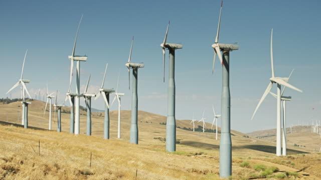 Rows on Wind Turbines on Hillside video