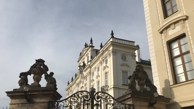 Royal gate with two pillars Royal wrought iron gate with art details and decorative facade sculptures in the background wrought iron stock videos & royalty-free footage