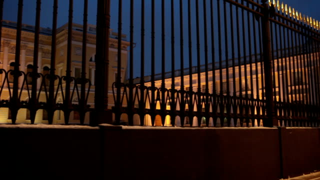 royal palace behind a high solid fence