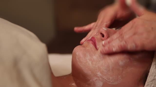 Rub Facial Cream on Face Dolly Right video