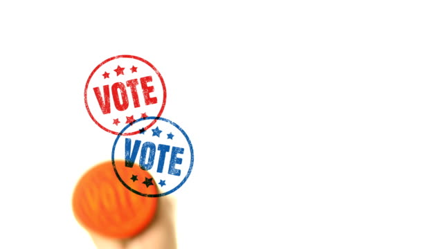 vidéos et rushes de vote en caoutchouc bleu et rouge cachet - vote