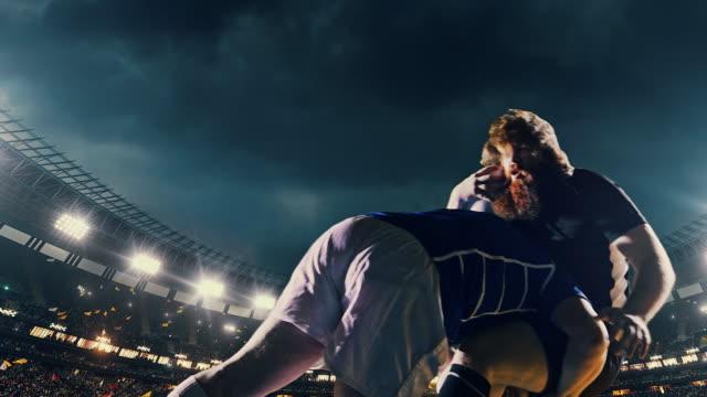 vídeos y material grabado en eventos de stock de jugador de rugby salta con una bola - rugby
