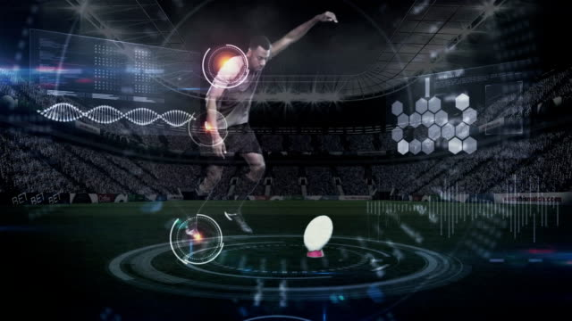 Rugby player kicking football from tee. Digital composite of African American rugby player kicking the football of tee while health is measured and projected on futuristic screen. athleticism stock videos & royalty-free footage