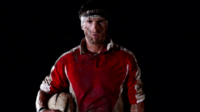 Rugby Player A rugby player looks up to camera rugby stock videos & royalty-free footage