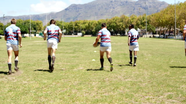 Rugby players running on the field 4K 4k video
