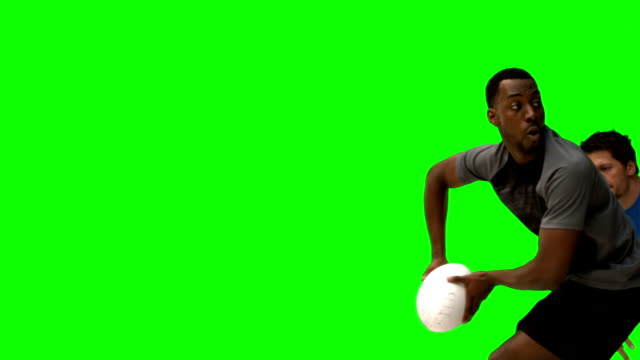 Rugby players tackling in slow motion video